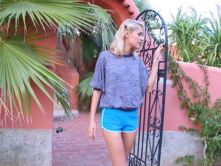 Blonde Skinny Beauty With Blue Short Pants Relaxes