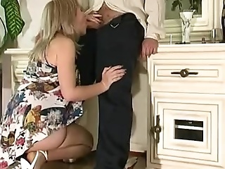 Half-naked Mature Smoker Serves A Young Cock On Her Knees
